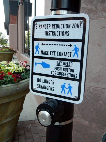 Stranger reduction zone -- Instructions -- Make eye contact -- Say hello. Push button for suggestions. -- No longer strangers