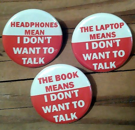 Headphones mean: I don't want to talk / The laptop means: I don't want to talk / The book means: I don't want to talk