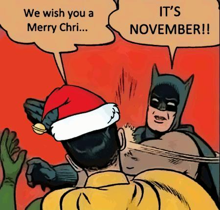 Mann mit Weihnachtsmannmütze sagt zu Batman: We wish you a Merry Chri... -- Batman haut ihm eine gepfefferte Backpfeife und sagt: IT'S NOVEMBER