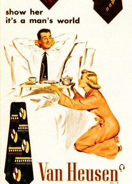 Krawattenreklame: Show her it's a man's world -- Frau serviert einem Mann knieend mit unterwürfiger Geste den Kaffee ans Bett