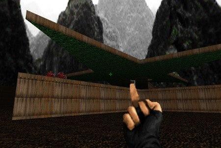 Ein Stinkefinger in die große Arena des letzten Levels der ersten Episode von Doom, nachdem die Bruiser Brothers zu Brei geschossen sind -- vor mir liegt der Tod durch Dämonenbisse und Schrotmunition beim Verlassen des Levels