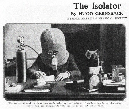 The author at work in his private study aided by the Isolator. Outside noises are eliminated, the worker can concentrate with ease upon the subject at hand