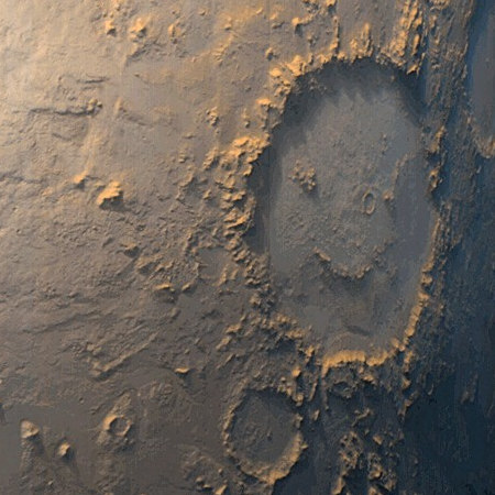 Mars Global Surveyor was greeted with this view of 'Happy Face Crater' smiling back at its camera from its location on the east side of Argyre Planitia