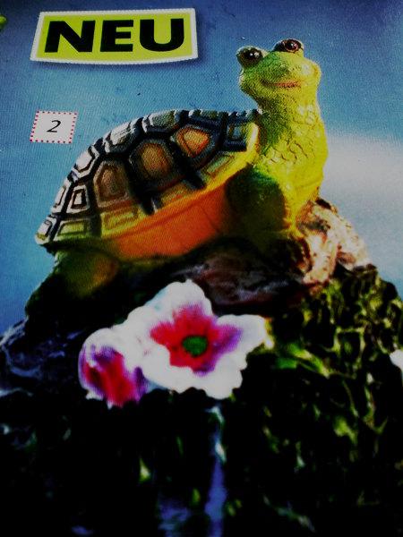Werbung. Über einer ausgesprochen kitschigen, glubschäugelnden Schildkrötenfigur steht das Wort 'Neu'.