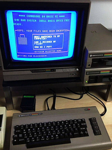 COMMODORE 64 BASIC V2 -- 64 K SYSTEM 38911 BASIC BYTES FREE -- READY. -- OOPS, YOUR FILES HAVE BEEN ENCRYPTED -- WHAT HAPPENED TO MY COMPUTER? -- CAN I RECOVER MY FILES? -- HOW DO I PAY? -- BITCOIN ACCEPTED HERE -- WAITING FOR BLOCKCHAIN