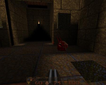 Screenshot aus Quake, auf dem Boden der Kopf eines gegibbten Fiend