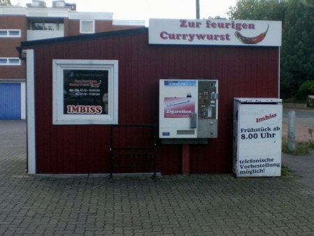 Imbiss mit dem Namen 'Zur feurigen Currywurst' und dem Angebot 'Frühstück ab 8:00 Uhr'.