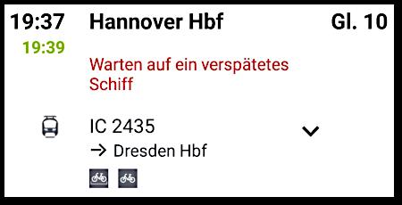 Detail aus einer Routenplanung aus der Website der Deutschen Bahn. Der IC 2435 von Hannover Hbf nach Dresden Hbf verspätet sich um zwei Minuten mit folgender Begründung: 'Warten auf ein verspätetes Schiff'.