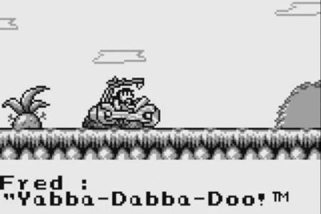Screenshot aus dem Gameboy-Spiel 'The Flintstones' mit dem eingeblendeten Text 'Yabba-Dabba-Doo!™