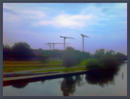 Sehr stark mit Gimp bearbeitetes Foto eines späteren Sommerabends an der Ihme in Hannover-Linden, geprägt von den Kränen auf der Baustelle des ehemaligen Elektrizitätswerkes. Wer sich dort auskennt: Das Bild ist natürlich für eine bessere Wirkung gespiegelt.